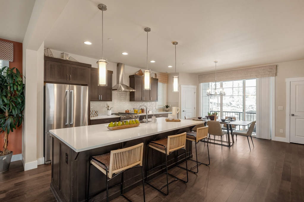 Large kitchen island with pendant lights above.