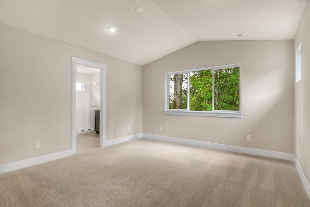 Big airy master bedroom with vaulted ceilings