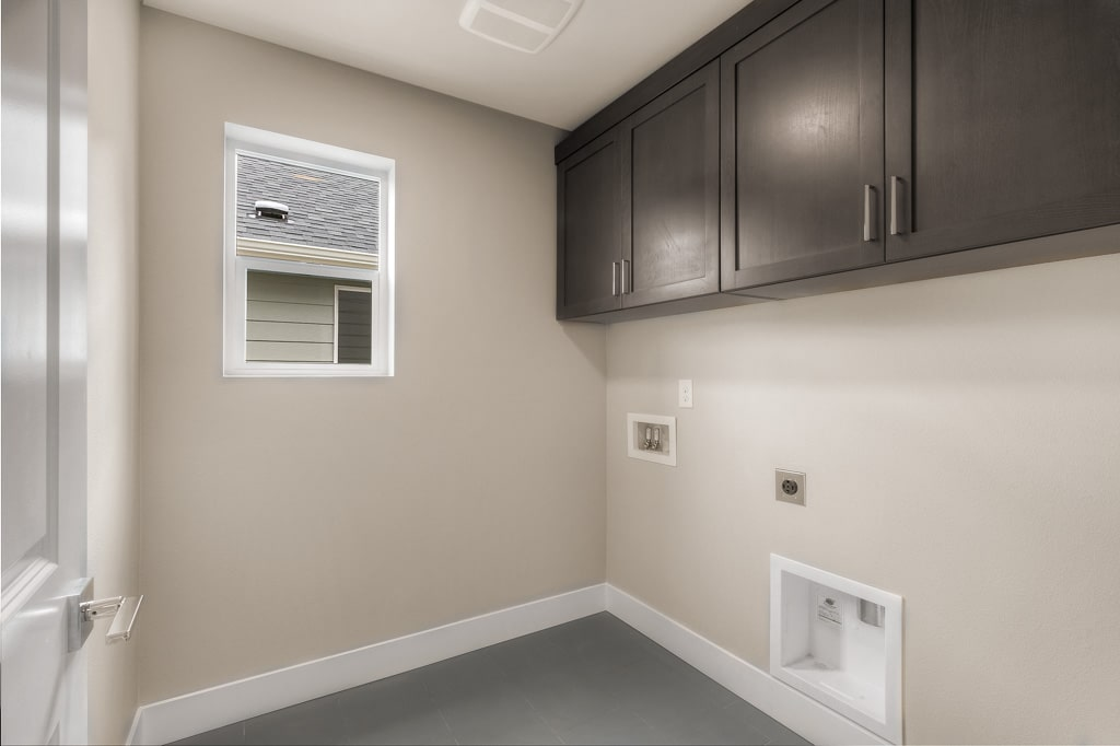 Upper cabinets included in laundry