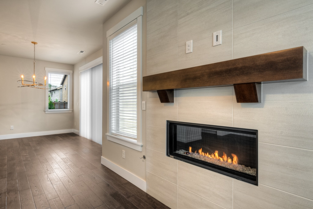 Gas fireplace with ceiling-height tile surround